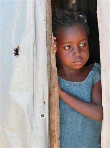 A child still living in a tent city for displaced families in Port-au-Prince