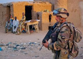 A French soldier patrols a small village in Mali