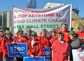 Members of National Nurses United protest the Keystone XL pipeline