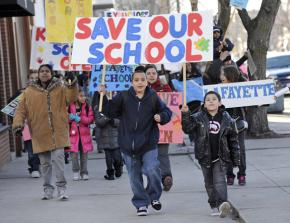 Students and parents at Lafayette Elementary School march against their school's threatened closure