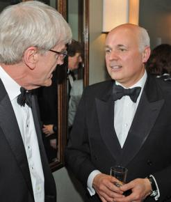 Conservative Party minister Iain Duncan Smith (right) comforts another hapless victim of the poor's avarice