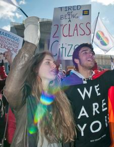 LGBT rights activists rally for marriage equality outside the Supreme Court