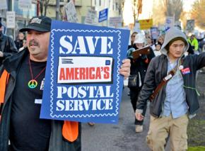 Postal workers march with supporters against cuts to USPS jobs and services