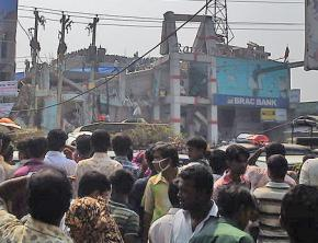 Waiting outside the collapsed garment factory building in Bangladesh