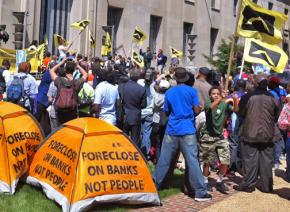Housing rights activists rally at the Department of Justice in Washington