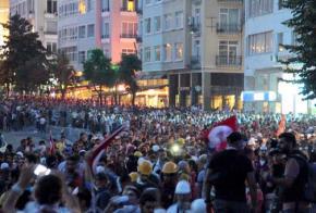 Democracy demonstrators fill Taksim Square at night