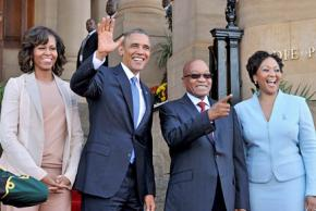 Left to right, Michelle and Barack Obama with South African President Jacob Zuma and his wife Tobeak Madiba