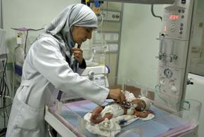 An infant receives treatment in a hospital in Falluja, Iraq