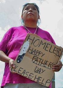 A Native American woman asks for donations near Minneapolis