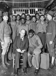 The Scottsboro Boys in prison, speaking with a lawyer