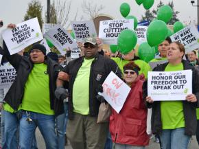 Walmart workers in Seattle on strike last year march for living wages and respectful conditions