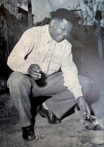 Nelson Mandela burning an identification pass in 1960