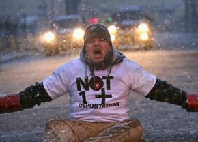 Protesters mark International Human Rights Day with a sit-in against deportations in Elizabeth, N.J.