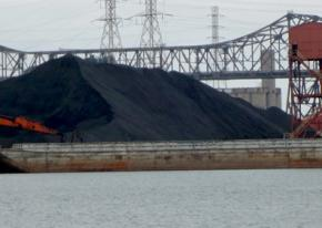 Petcoke piles loom over the banks of the Calumet River in Southeast Chicago