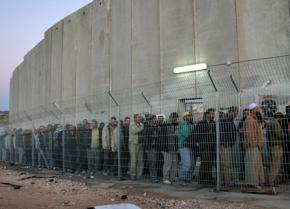 Palestinians caged in at an Israeli checkpoint in the West Bank