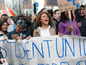 Jefferson High School students march through the streets of Portland after walking out