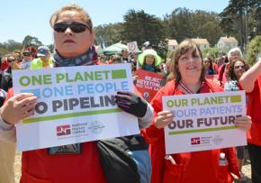 Nurses protest the Keystone XL pipeline project as a threat to the health of people and the planet