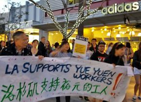 Los Angeles marchers show their solidarity with Chinese strikers