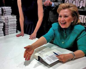Hillary Clinton signing copies of her new book