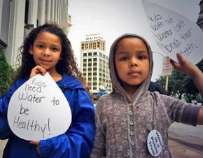 Kids join in a protest against the planned shutoff of water services