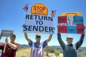 Anti-immigrant bigots protest detainees in Murrieta, Calif.