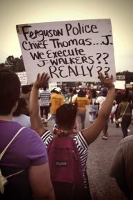 Marching along West Florissant in Ferguson, Mo.