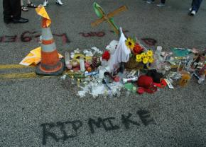 A shrine for Mike Brown on the street where he was killed in Ferguson