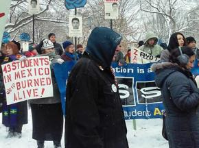 Protesters endure the winter weather outside the White House during Enrique Peña Nieto's visit