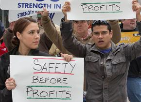 Striking oil workers rally to demand safety come before profits
