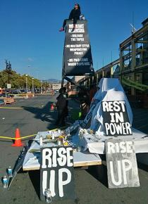 Protesters built a 30-foot-tall shrine to Yuvette Henderson in front of the entrance to Home Depot