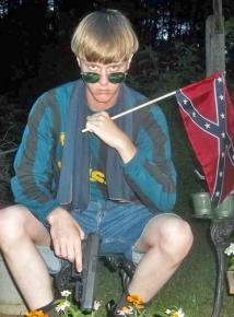 Dylann Roof poses with a Confederate flag and handgun