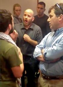 UT professor Ami Pedhazur (center, speaking) confronts a student (left) speaking on behalf of the Palestine Solidarity Committee