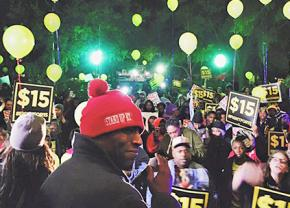 Fight for 15 worker activists protest outside the Democratic presidential debate in Charleston, South Carolina