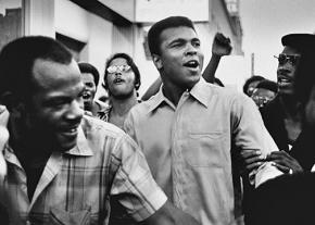 Muhammad Ali in the streets of the New York City with members of the Black Panther Party