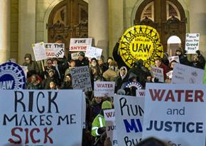 UAW members join protests outside the Michigan Capitol building