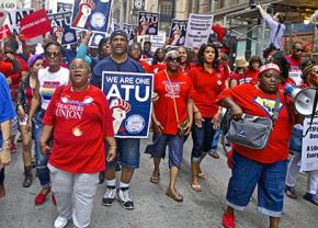 Chicago teachers, transit workers and community members march for a just city