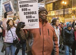 CTU teachers march against layoff threats and budget cuts