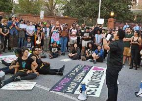 Protesters challenge an anti-LGBT law outside the North Carolina governor's mansion