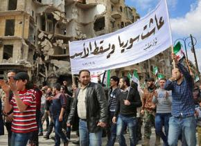 Syrian protesters march against the Assad regime near Aleppo