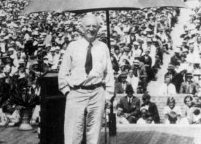 Upton Sinclair stands before a crowd during his campaign for governor of California