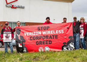 Strikers and supporters picket outside a Verizon Wireless store