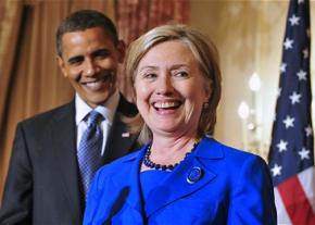 Hillary Clinton speaks as Barack Obama looks on