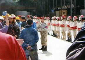 Military police surround the striking shipyard workers in Alexandria