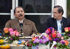 Nicaraguan President Daniel Ortega (left) speaks at a press conference alongside Ecuador's Foreign Minister Ricardo Patiño