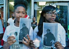 Family and friends participate in a vigil for Delrawn Small