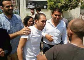 Malek Adly (center) after his release from prison