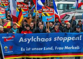 Supporters of Alternative for Germany march against asylum for refugees in Leipzig