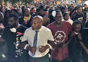 Protesters in Charlotte defy a curfew to march for justice for Keith Lamont Scott