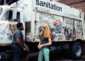 Artist Mierle Laderman Ukeles speaks with a sanitation worker in New York City