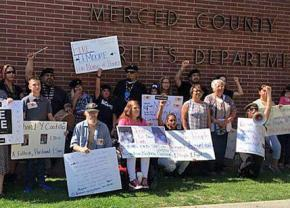 Community members rally in support of hunger strikers at the Merced County jail